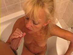 Horny old cocksucker gives a BJ in the bath Thumb
